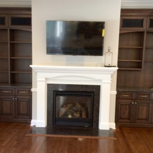Feature Mantle with Fireplace and Built-Ins with Wall-Mounted HDTV