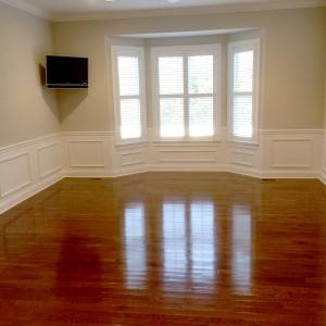 Spacious Room with Hardwood Floors and Flowing Natural Light